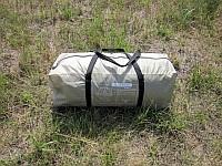 В сложенном, транспортном положении, тент-палатка Cook Room и все его комплектующие детали - дуги, стойки, колышки и растяжки, умещаются в сумку