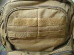 Малый накладной карман рюкзака RUSH 72 имеет объем в поллитра