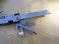 Напильник по дереву и металлу, консервный нож, открывалка для бутылок, отвертки, мультитула SOG PowerAccess, обзор